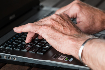 Aging hands on keyboard